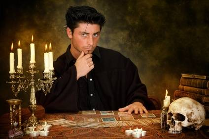 Halloween scene of a young astrologist reading tarot cards
