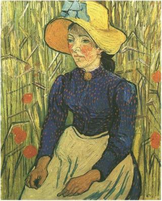 campesina-con-sombrero-de-paja-sentada-en-el-trigal.jpg